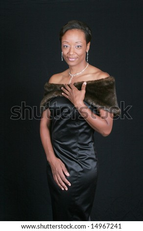 Lovely black woman with hand to her chest - stock photo