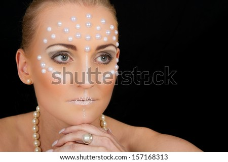 Lovely blond woman portrait with creative make-up and white spots - stock photo