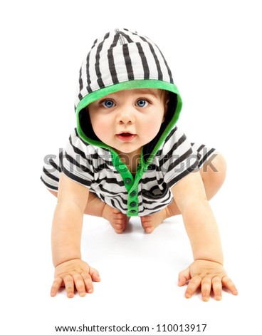 Lovely boy isolated on white background, sweet little baby wearing striped sliders, charming small kid in black & white hoodie with biggin crawling indoors, happy childhood conception - stock photo