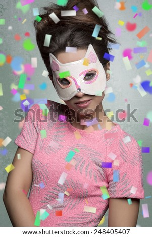 lovely brunette woman posing in carnival portrait with cat mask creative hair-style and stylish pink t-shirt.  - stock photo