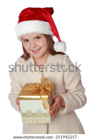 lovely child in a Santa hat with Christmas present - stock photo