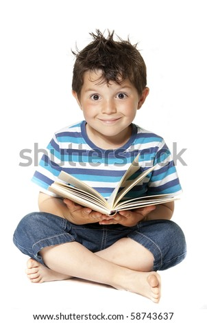 Lovely child reading a book - stock photo