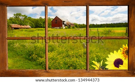Lovely country landscape seen through an old farmhouse window.  Part of a series. - stock photo