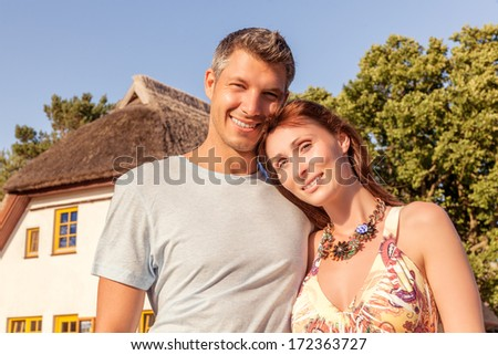lovely couple beyound house outdoor - stock photo