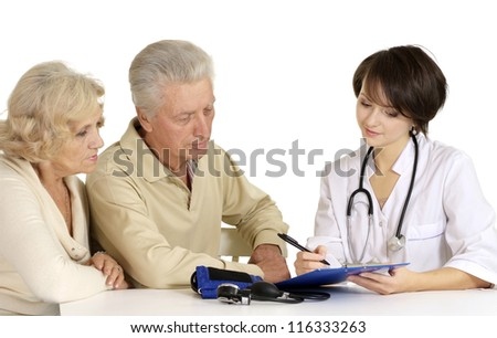 Lovely couple came to the reception to the young doctor - stock photo