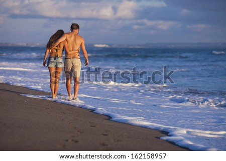 lovely couple on beach. - stock photo