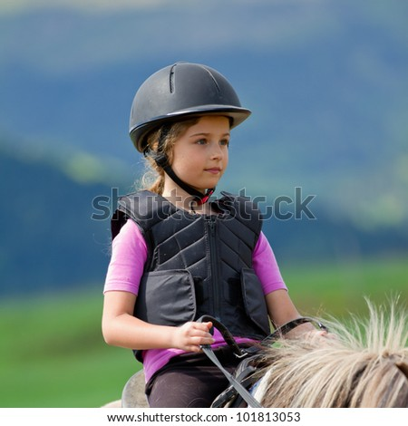 Lovely equestrian - stock photo