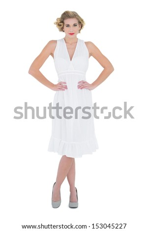 Lovely fashion blonde model posing with hands on the hips on white background - stock photo