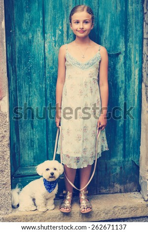 Lovely fashion girl with maltese dog - stock photo