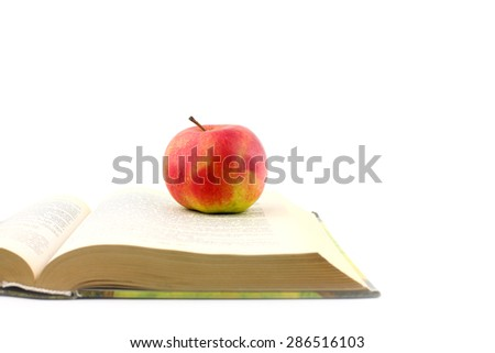 Lovely fresh ripe apple and book pages - stock photo