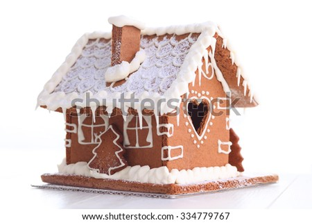 lovely gingerbread house on white - sweet food - stock photo