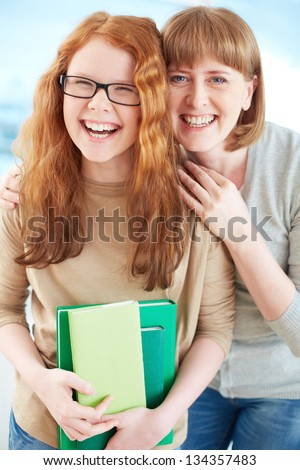 Lovely girl and her mother laughing - stock photo