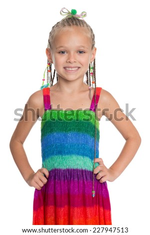 Lovely girl in a colorful summer dress isolated on white background. Girl is six years old. - stock photo