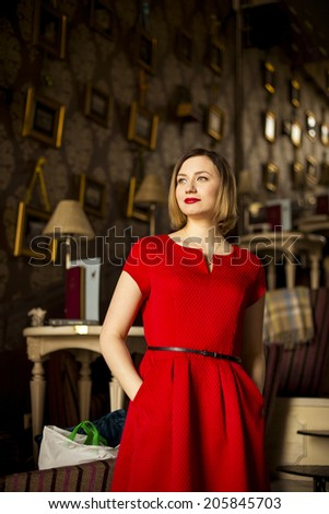 Lovely girl in a red dress - stock photo