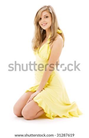 lovely girl in yellow dress over white - stock photo