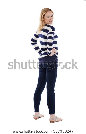 Lovely girl turning back and smiling at the camera - stock photo