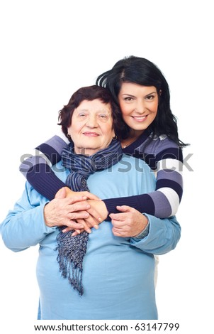 Lovely granddaughter hugging her grandmother isolated on white background - stock photo
