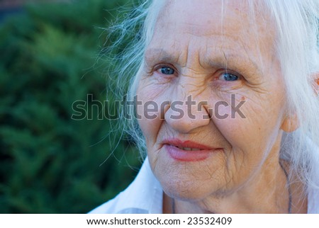 Lovely grandmother outdoor - stock photo