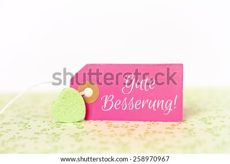 lovely greeting card - german for get well soon - stock photo
