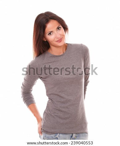 Lovely hispanic female in grey blouse looking at you while smiling in white background - stock photo