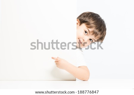 Lovely kid pointing card board with good expression - stock photo