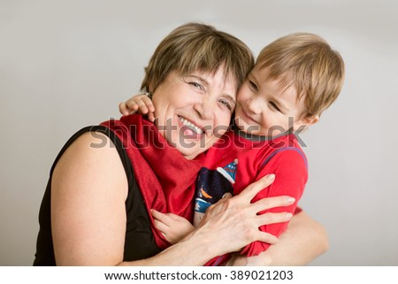 Lovely little boy with his grandmother having fun and happy moments together at home - stock photo