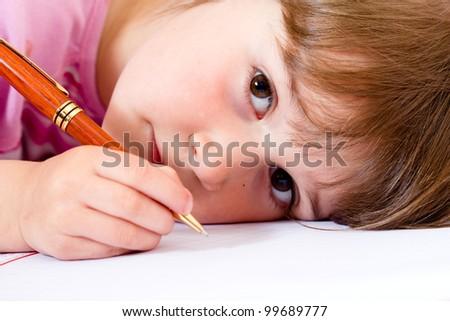 Lovely little girl learning to write - stock photo