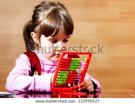 Lovely little girl learning with abacus - stock photo
