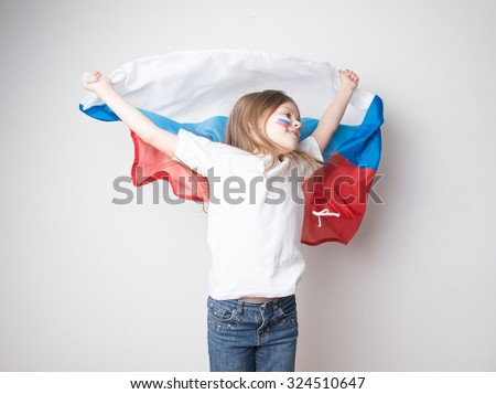 Lovely little girl with a Russian flag - stock photo