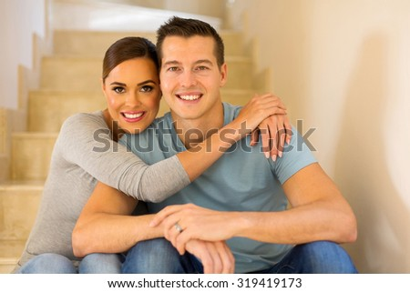 lovely married couple relaxing at home - stock photo