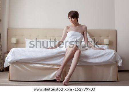Lovely model with short hair posing in bedroom - stock photo