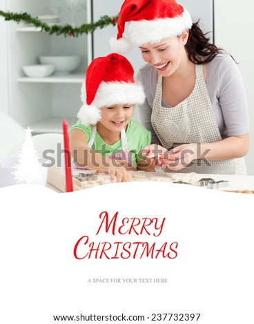 Lovely mother and daughter preparing Christmas cookies against merry christmas - stock photo