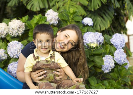 Lovely Mother with Her Children, Enjoying Together - stock photo