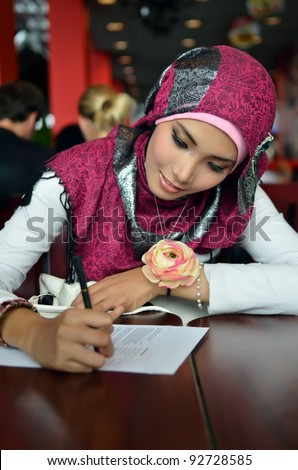 Lovely of young Asian businesswoman filling the form on job interview - stock photo