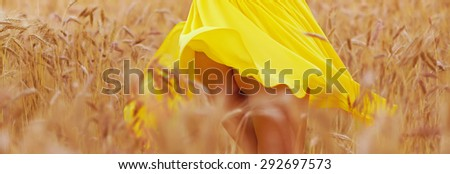 lovely part of young seductive girl in summer wheat field - stock photo