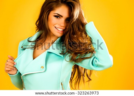 Lovely portrait of pretty smiling woman,autumn concept image- happy stylish,glamour girl,amazing hairstyle,curly hair,long dark wavy hairs,colored outfit,warm clothes,positive emotions,white teeth - stock photo