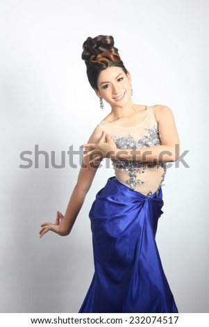 Lovely pretty with thai traditional dancing in modern clothes - stock photo