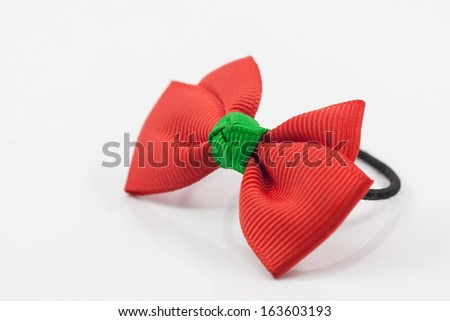Lovely red hairpin isolated on white background - stock photo
