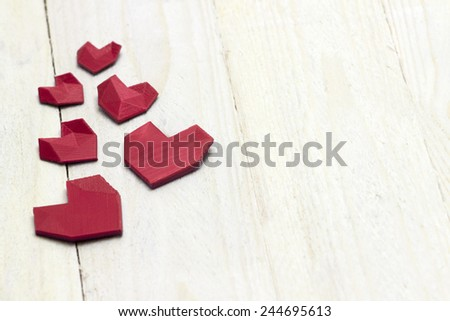 Lovely red heart's on the white wood floor template. Photography of 3d printed object. - stock photo