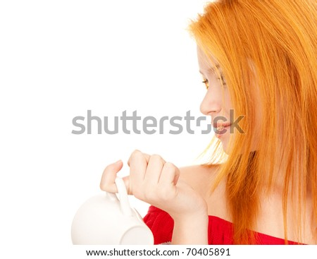 lovely redhead with white cup on breakfast - stock photo