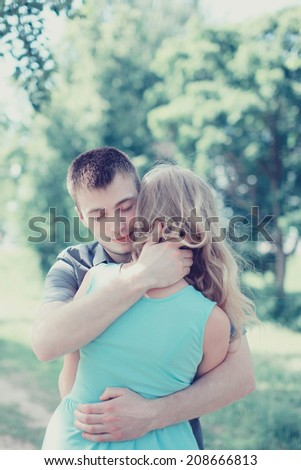Lovely sensual couple in love, man embracing woman, warm feelings, vintage photo pastel color - stock photo