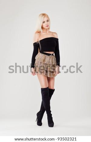 Lovely sexy girl in leopard short skirt against white background - stock photo