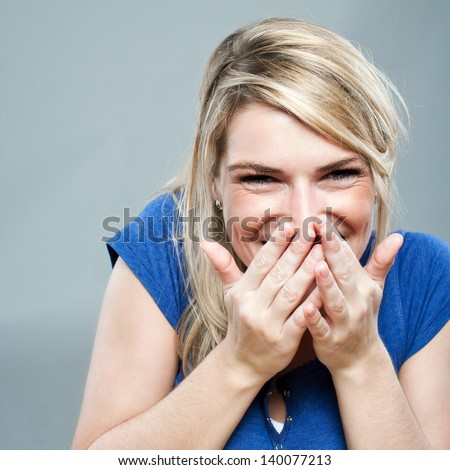 Lovely shy woman lauging - stock photo