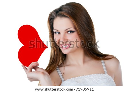 Lovely smiling woman holding a heart, isolated on white background - stock photo