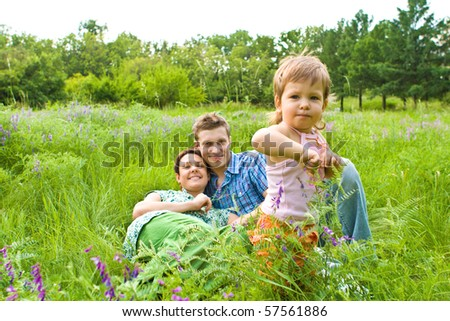 Lovely toddler in grass - stock photo