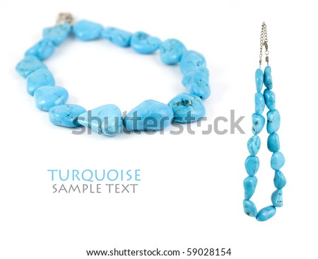 Lovely turquoise necklace isolated on pure white background. Copy-space. - stock photo