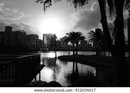 Lovely view of the lake in the park Iola/Lake and palms/Please visit my portfolio for more photos like this! - stock photo