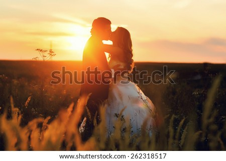 lovely wedding couple in sunset - stock photo
