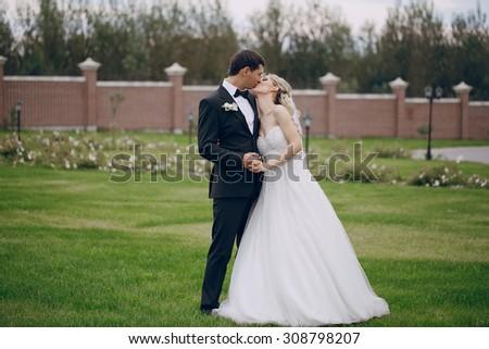 lovely wedding couple walking on their wedding day - stock photo
