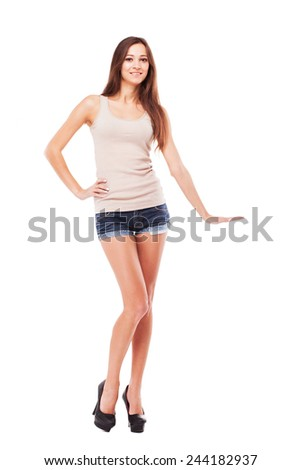 Lovely woman demonstrating something imaginary against white background - stock photo